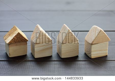 background with the concept of Cascade wooden houses on the dark wooden surface / new individual houses