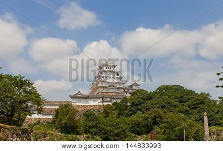 HIMEJI JAPAN - JULY 21 2016: Main keep (tenshukaku) of Himeji castle (White Egret Castle circa 1609) after repairing works ended 2015. National Treasure of Japan and UNESCO World Heritage Site