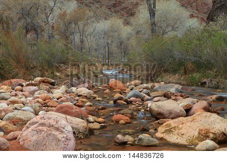 Rock and boulder strewn creek with softly flowing water