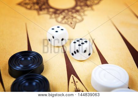 Game field in a backgammon with cubes and counters. Game concept