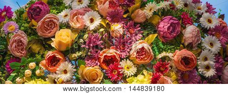 Decorative flower arrangement of roses, lilies and other flowers