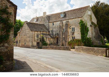 Old street in  Bibury (Arlington Mill),  Gloucestershire,  England, UK.