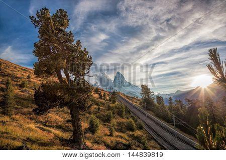 Matterhorn Peak With Railway Against Sunset In Swiss Alps, Switzerland