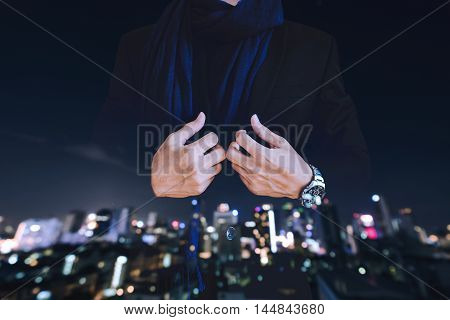 Businessman in casual suit with multiple exposure defocused city at night background