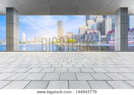 abstract architectural column with city skyline background,shanghai,china.