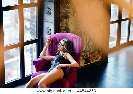 Beautiful Sexy Lady In Elegant Black Bodysuit. Close Up Fashion Portrait Of Model Indoors. Beauty Bl