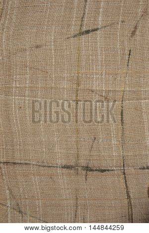 Photo of the Natural linen cloth background. Organic fabric texture patterns. Vertical