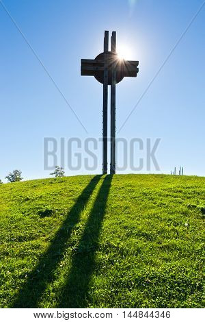 Celtic cross against the blue sky, Celtic oppidum,  Dolni Brezany near Prague, Czech republic