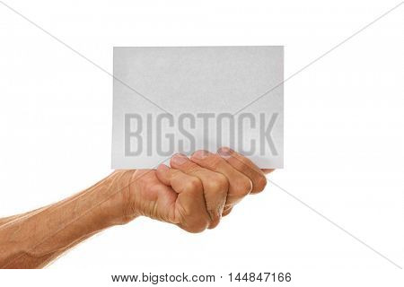 Old man hand holding sheet of paper on a white background
