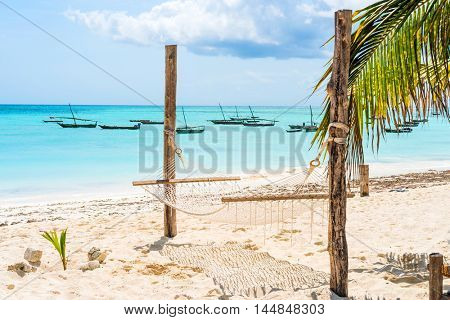 beautiful colorful seascape with hammock and palm on a beach