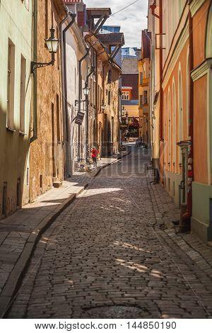 Estonia Tallinn - 5 JUNE 2016: Narrow old street at Old Town (historiacal part of Tallinn)