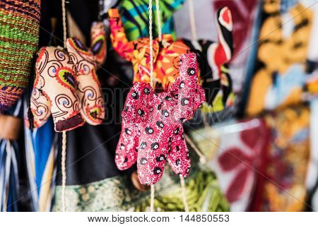 colorful small fabric handmade toys at african traditional market
