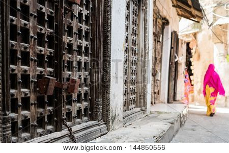 huge iron forged gate door on african street