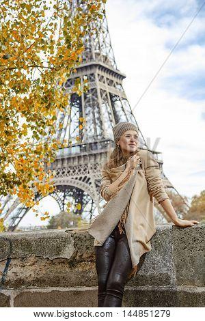 Elegant Woman On Embankment In Paris, France Looking Aside