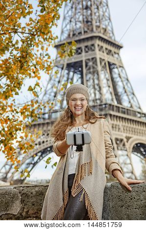Elegant Woman Taking Selfie Using Selfie Stick In Paris, France