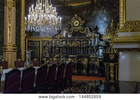 PARIS, FRANCE - MAY 13, 2015: This is dining room with the preserved interior of the times when they lived Emperor Napoleon III in the Louvre.