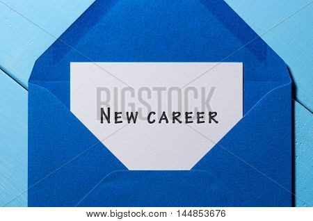 New Career written on the white paper at blue envelope. New opportunity, facilities concept.