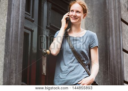 Urban Portrait Of A Woman On The Phone