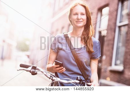 Woman In City - Bicycle And Mobile Phone