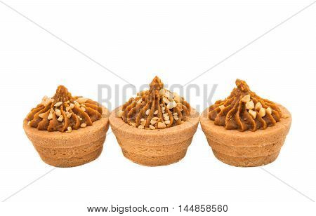 Sand basket with cream on a white background