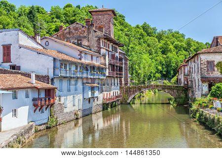 Arc bridge over the river La Nive de Beherobie in small town Saint-Jean-Pied-de-Port Aquitaine France