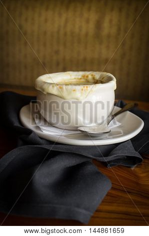 French onion soup with crispy gruyere cheese baked to perfection