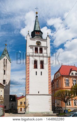 White bell tower in the historical centre of Vimperk, Southern Bohemia, Czech Republic