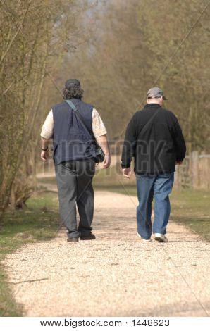 Two Men Walking Away Fom View