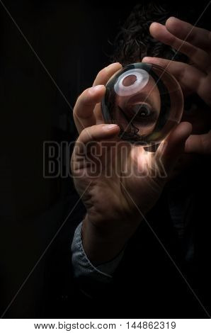 Holding magic crystal ball in fortune teller business background