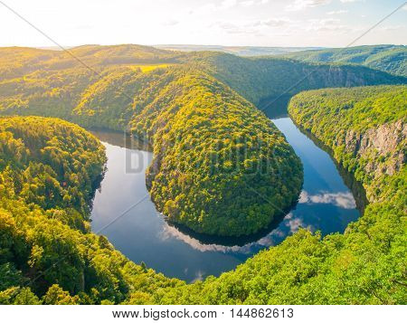 Beautiful forest landscape with river meander in deep valley, Vltava River, Czech Republic