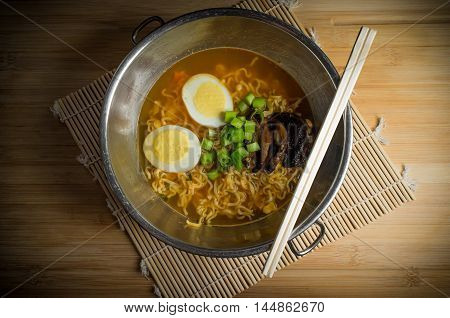 Korean cuisine ramen noodle soup with mushrooms and hard boiled eggs
