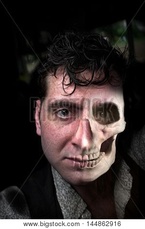 Horror portrait of man with skull for half his face