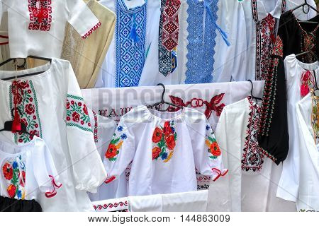 traditional national Ukrainiane handiwork embroidered and decorated shirts dresses and towels popular nowadays in Ukrain as manifestation of national authentication and as just a modish style