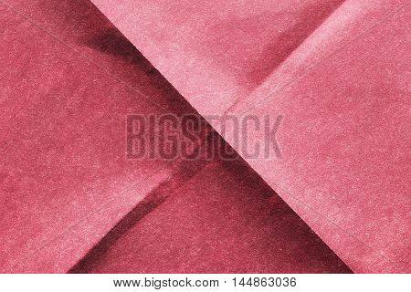 Blank pink folded paper as a background