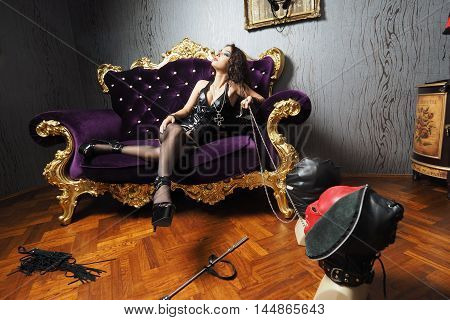 Mistress play with whip in leather and underwear sexy
