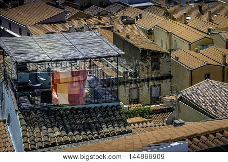 A rooftop balcony with laundry in Sardinia