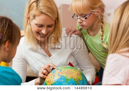 Family affairs - mother explaining the world to her children; presumably she is a teacher