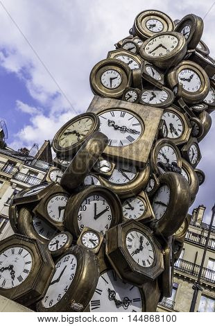 Clock sculpture by Armand Pierre Fernandez entitled Accumulation is situated at the entrance to St. Lazare Station, Paris
