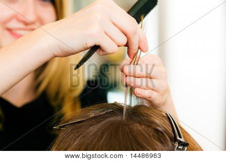 At the hairdresser � woman gets new hair colour; close-up on hands