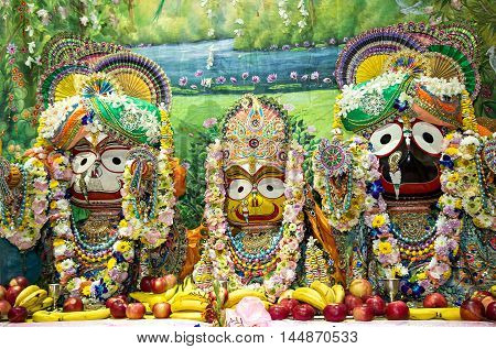 Indian deities on the altar: Lord Jagannath with his elder brother Balabhadra and sister Subhadra.