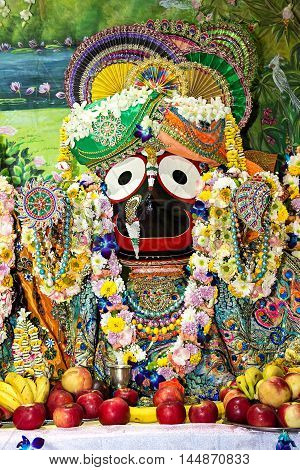 Indian deity Jagannath on the altar decorated with flower garlands.