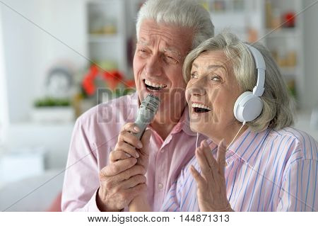 Portrait of a senior couple and microphone