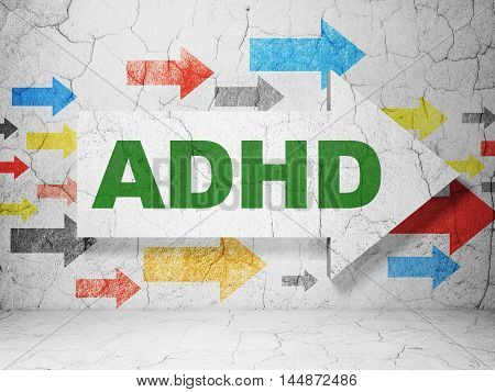 Health concept:  arrow with ADHD on grunge textured concrete wall background, 3D rendering
