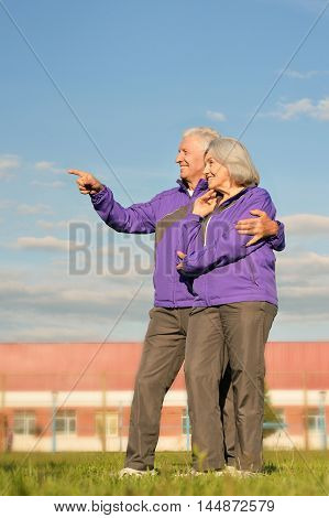 beautiful elderly couple  outdoor, man pointing at something