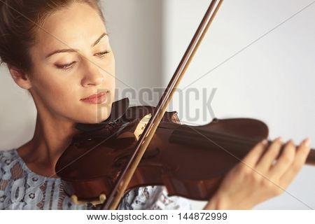 Beautiful woman playing violin
