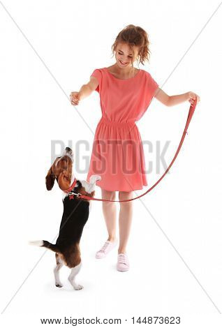 Young woman walking dog isolated on white