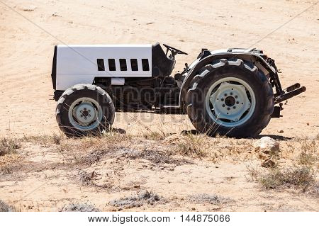Empty Gray Tractor With Black Details, Side View