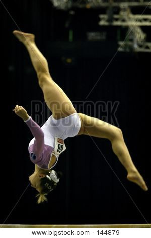 Gymnast Somersaulting On Beam
