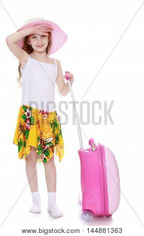 Tired little girl in a pink hat and a white tank top without a pattern . Girl holding hand pink suitcase - Isolated on white background
