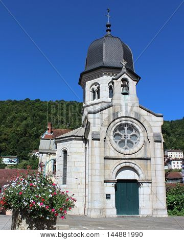 Exterior view of the 19th century Chapel of Carmes in Saint-Claude, in the Jura region of France.